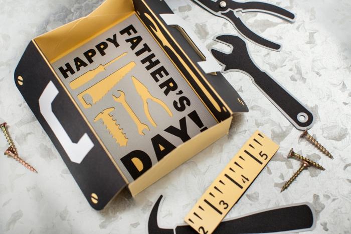 cadeau fete des peres a fabriquer, modèle de boîte en carton avec décoration outils en papier découpés, activité manuelle fête des pères
