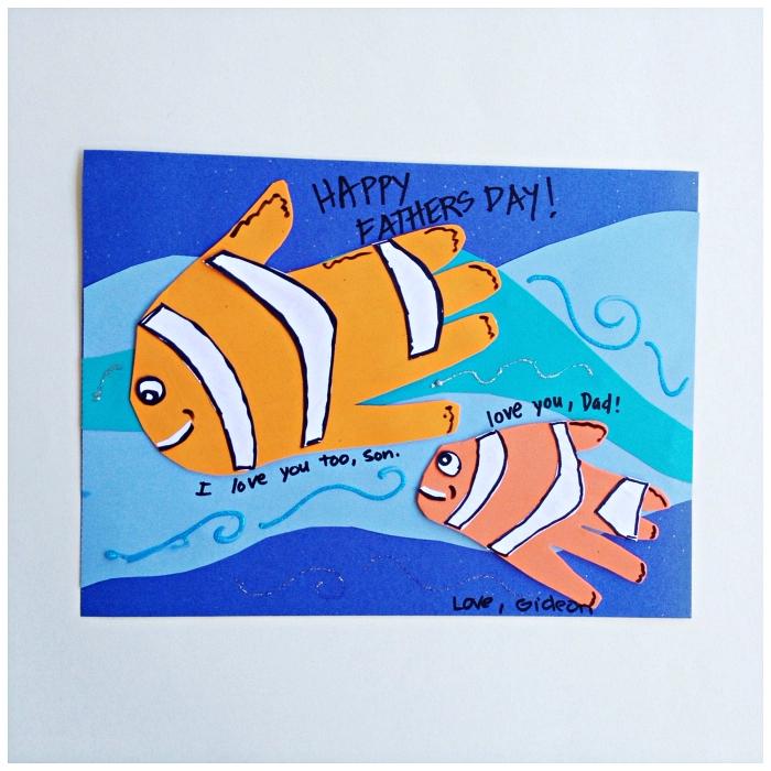 idée de cadeau fete des peres a fabriquer à l'école maternelle, une carte pour la fête des pères d'air marin avec poissons empreintes de mains