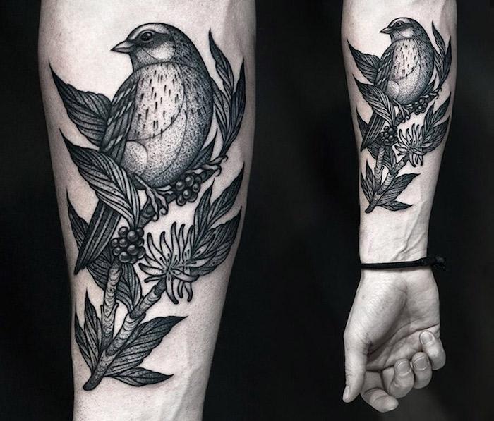 oiseau tatouage original en noir sur bras, modele tattoo design d oiseau perché sur une branche fleurie