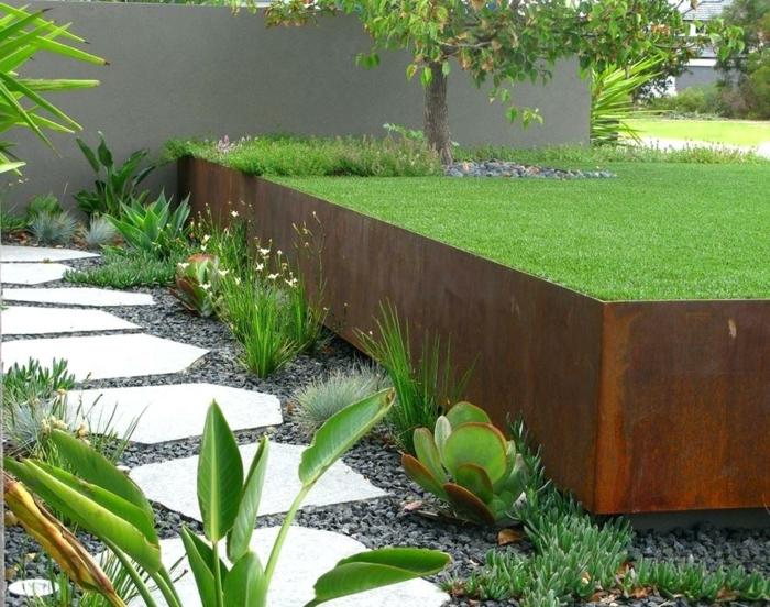 parterre surélevé allée de jardin en dalles gravier noir plantes exotiques, déco jardin paysager