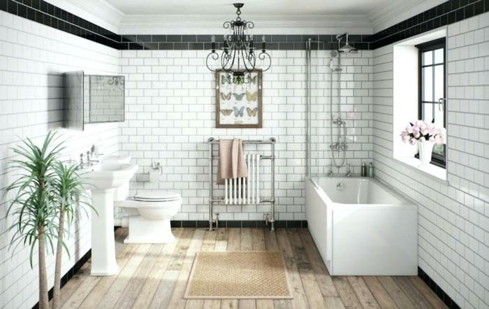 salle de bain bois et blanc, baignoire rectangulaire, plafonnier noir, lavabo colonne, faience salle de bain noir et blanc