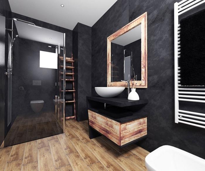 décoration salle de bain noire au plafond blanc avec plancher imitation bois, modèle meuble sous vasque en noir