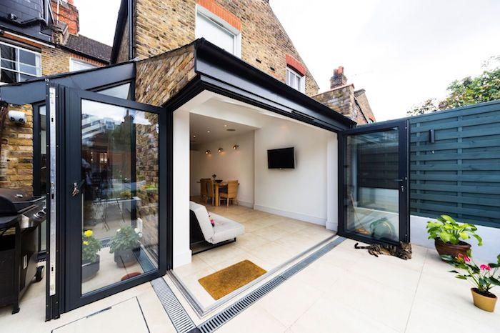 agrandir sa maison avec un garage améanagé en surface habitable maison munie de verrière, coin bureau et repos