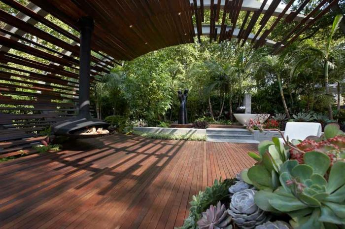 jardin paysager, foyer suspendu, plantes grasses, tonnelle en bois, aménagement paysager minimaliste