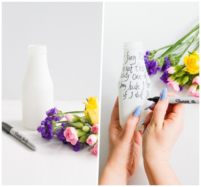 bouteille vase blanche décorée de script inspirant, bouquet de fleurs printanières, centre de table