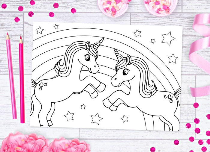 dessins pour coloriage sur le thème des licornes, dessins pour coloriage en ligne, coloriage licorne jouant devant un arc-en-ciel