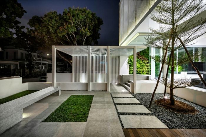 creation jardin paysager, terrasse en dalles, gazon vert, gravier décoratif, arbre abri de jardin contemporain, maison cubique