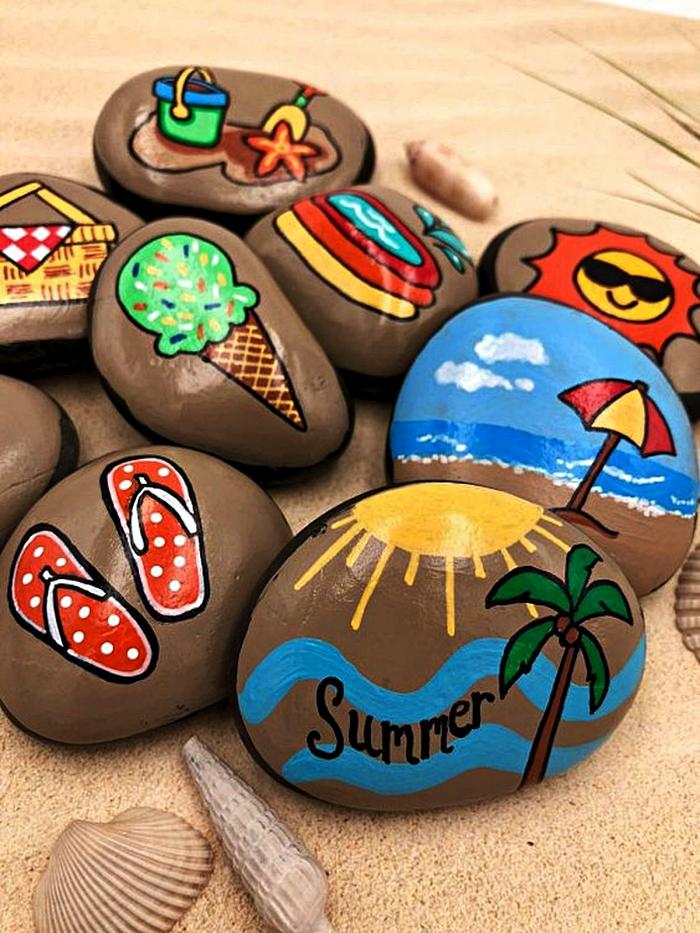 activité manuelle été avec galets décoratifs, des galets peints à la main avec motifs estivaux, galet peint cornet de glace, paysage bord de mer