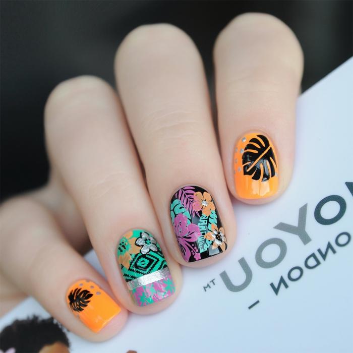 modele nail art ethnique, feuille noire, motifs folkloriques, fleurs stylisées, ongles en orange néon