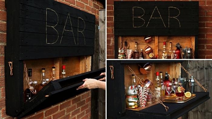 meuble de bar mural en palette repeinte en noir à l'extérieur avec porte basculante