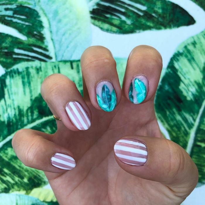 manucure rayée, feuilles tropicales, ongle en rose et blanc, dessin ongle ete, motifs exotiques