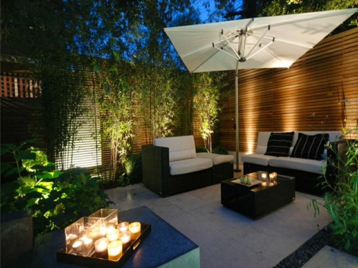 jardin paysager, parasol blanc, sofas de jardin, bambous plantés, plantes vertes, canisse bambou, jardin deco paysagère