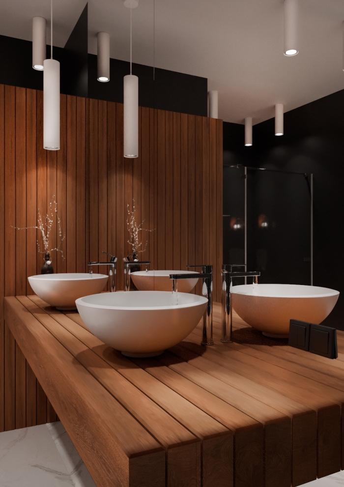 design intérieur moderne dans une salle de bain au plafond et sol blancs avec murs noirs et pan de mur en bois