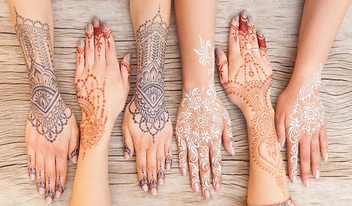 photo de henné de différentes couleurs à design ethnique, modèle de henné rouge naturelle aux motifs mandala