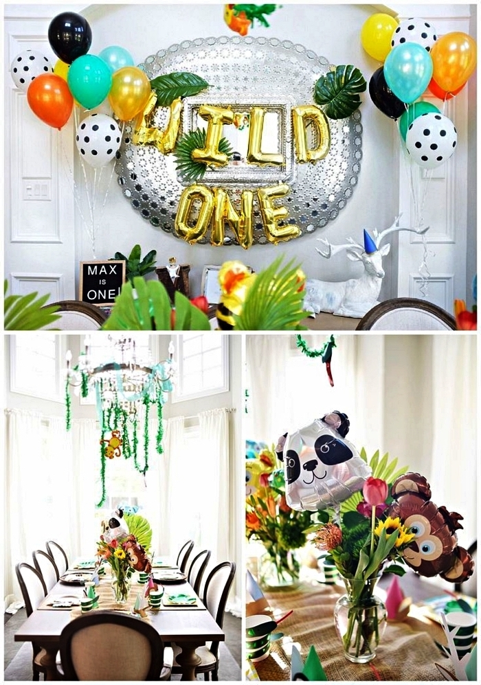 décoration anniversaire 1 an sur le thème jungle avec ballons et feuilles tropicales artificielles, déco de table avec ballons animaux de la jungle et bouquets de fleurs