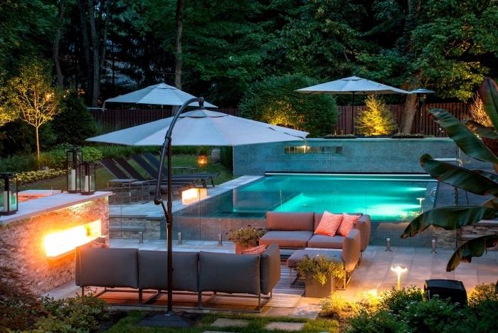 image piscine moderne avec terrasse en béton, exemple de mobilier de jardin style contemporain en fer et gris