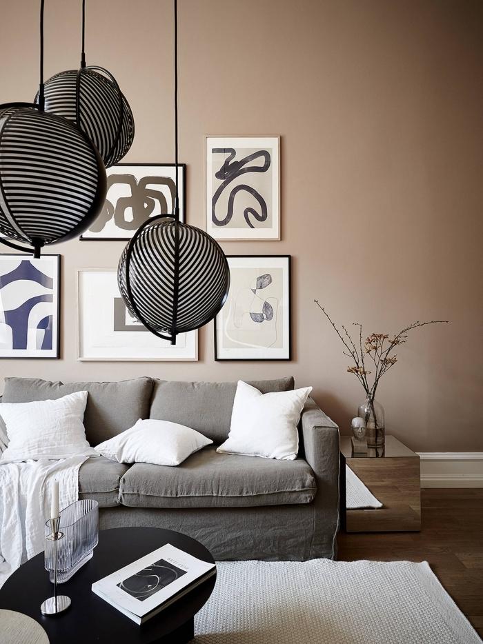 design intérieur moderne dans un salon en couleurs neutres, idée peinture beige dans un salon avec meubles en gris et bois