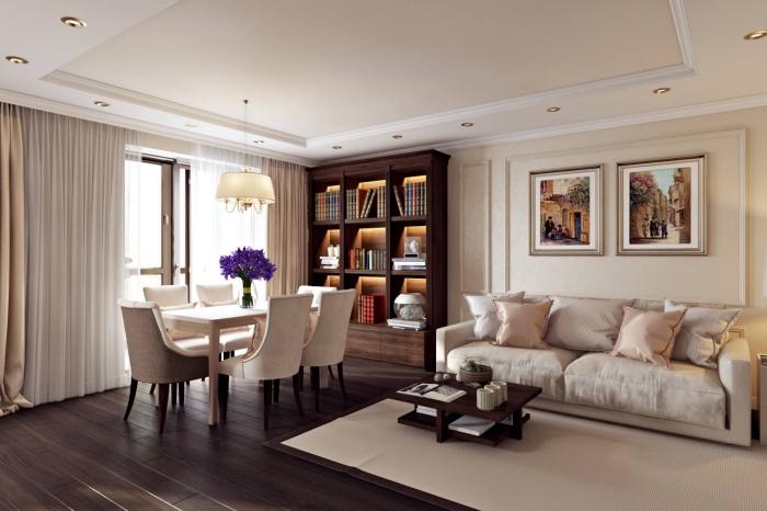 aménagement pièce classique en teintes brune et accents de couleur creme, modèle bibliothèque en bois foncé avec éclairage intégré