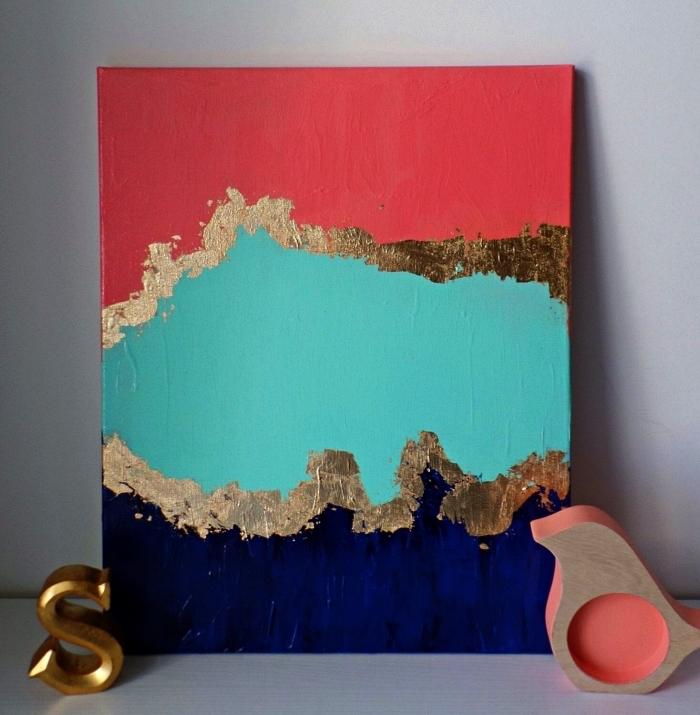 peinture moderne géode à l'acrylique en rouge, bleu et or, tableau abstrait à l'acrylique en déco de salon