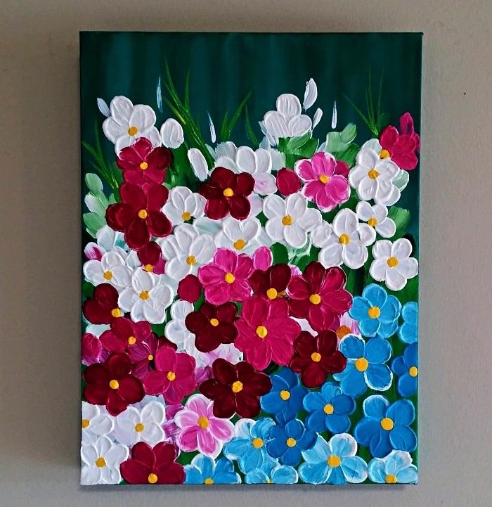 tableau peinture en relief composition florale à l'acrylique sur fond bleu nuit
