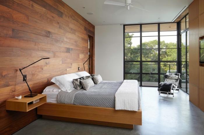 décoration chambre adulte au plancher effet béton et murs en planches de bois, chambre adulte de style moderne avec accents rustiques