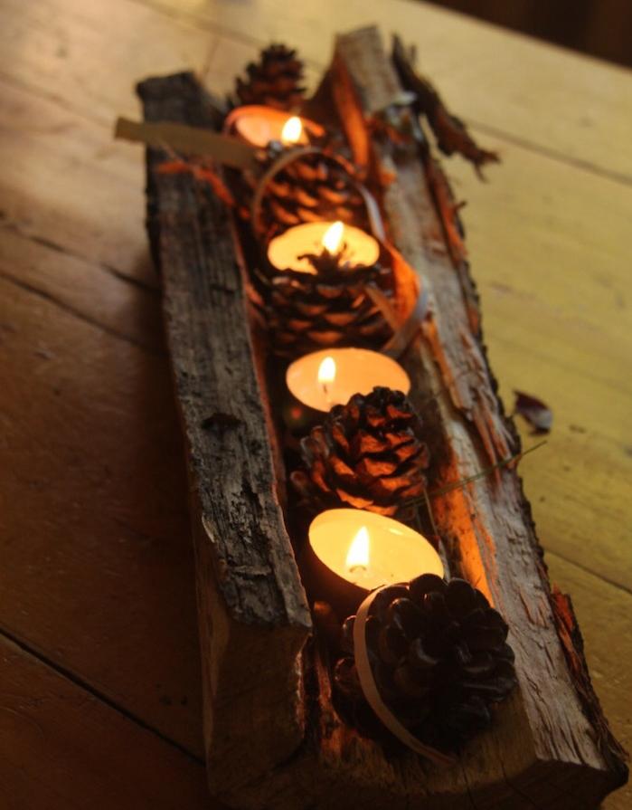 centre de table automne, creation avec des pommes de pin, branche bois flotté recyclé avec bougies et pommes de pin