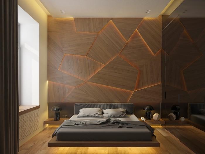 idée panneau mural décoratif pour chambre adulte, décoration pièce moderne aux murs beige avec pan de mur bois