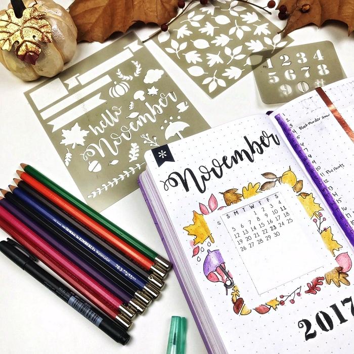 idée bullet journal page de garde décorée au pochoir, mise en page avec calendrier mensuel encadré de feuilles d'automne