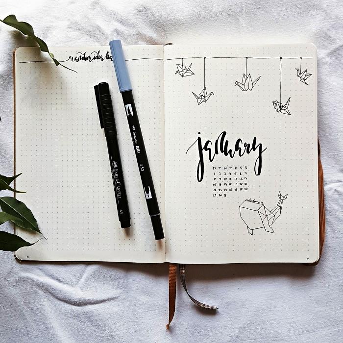 bullet journal page de garde au design minimaliste décoré de lettrage manuscrit et dessins origami