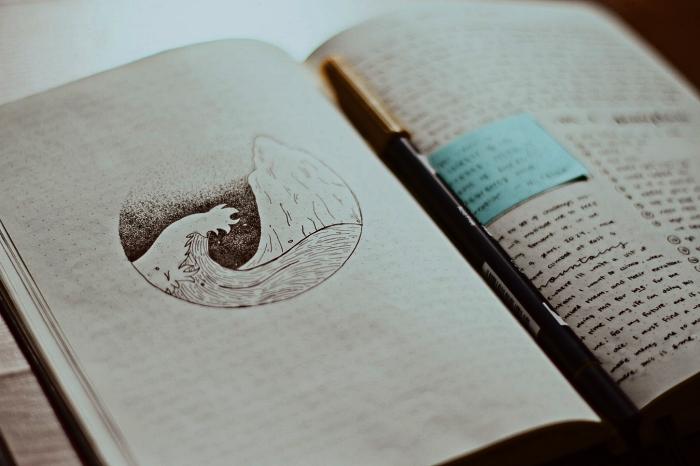 dessin bullet journal vague et montagne dans un petit cercle, exemple d'une page de garde créative