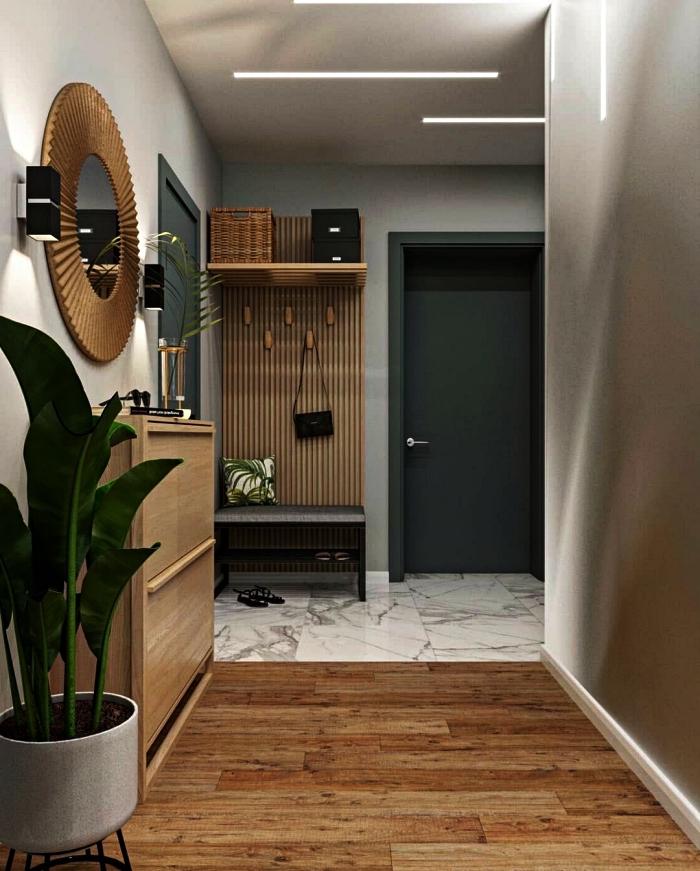 penderie entrée en bois vintage avec banquette installée dans un petit hall d'entrée au sol en marbre