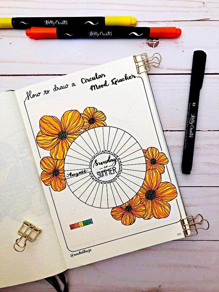 idée de bullet journal tracker d'humeur circulaire décoré de dessins fleurs, des pinces à papier pour bullet journal