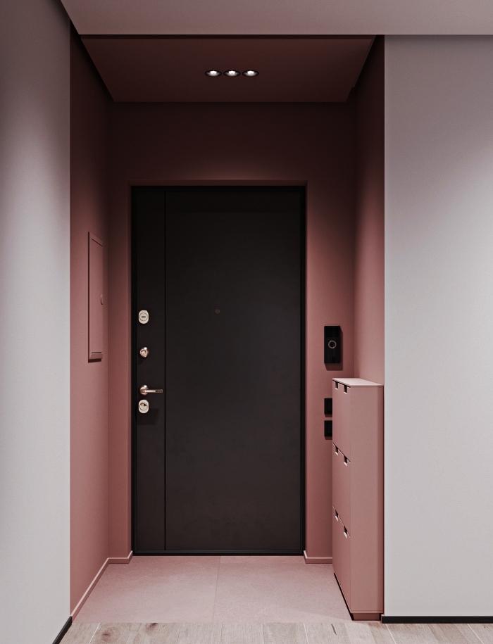 idée peinture couloir et entrée, petite entrée peint en rose poudré contrastant avec la porte d'entrée gris anthracite