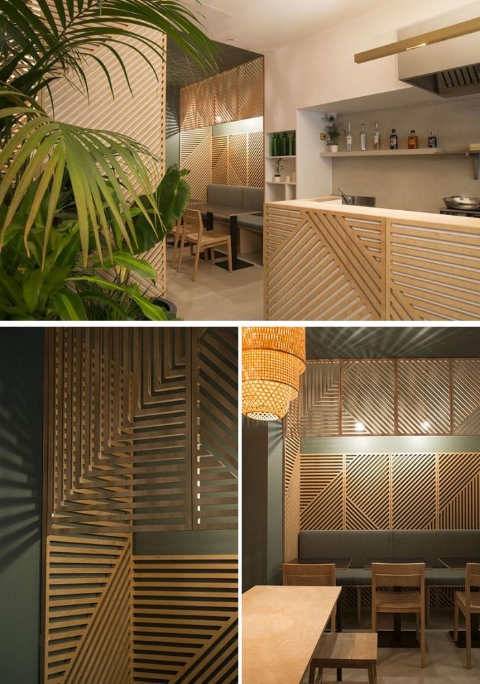 comment décorer une pièce avec mur en bois séparateur, aménagement cuisine aux murs blancs avec crédence béton et pan de mur en bois