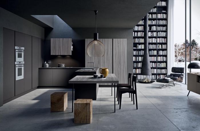 modèle de cuisine noir mat aménagée en l avec îlot table à manger, design intérieur moderne aux couleurs foncées