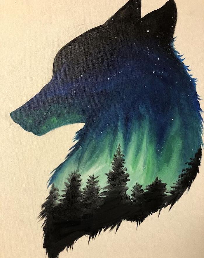 silhouette de tete de loup avec paysage dessiné à l intérieur, dessin paysage tribal d aurore boréale polaire