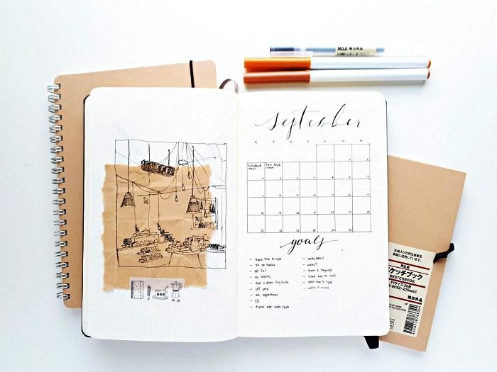 idée bullet journal minimaliste, mise en page planning mensuel accompagné d'un petit dessin et d'un bout de papier kraft