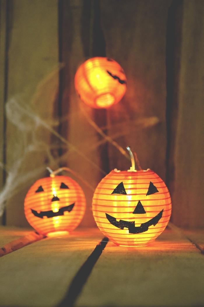 écran verrouillage portable avec citrouilles Halloween, idée wallpaper portable pour la fête de Halloween avec citrouille lumineuse