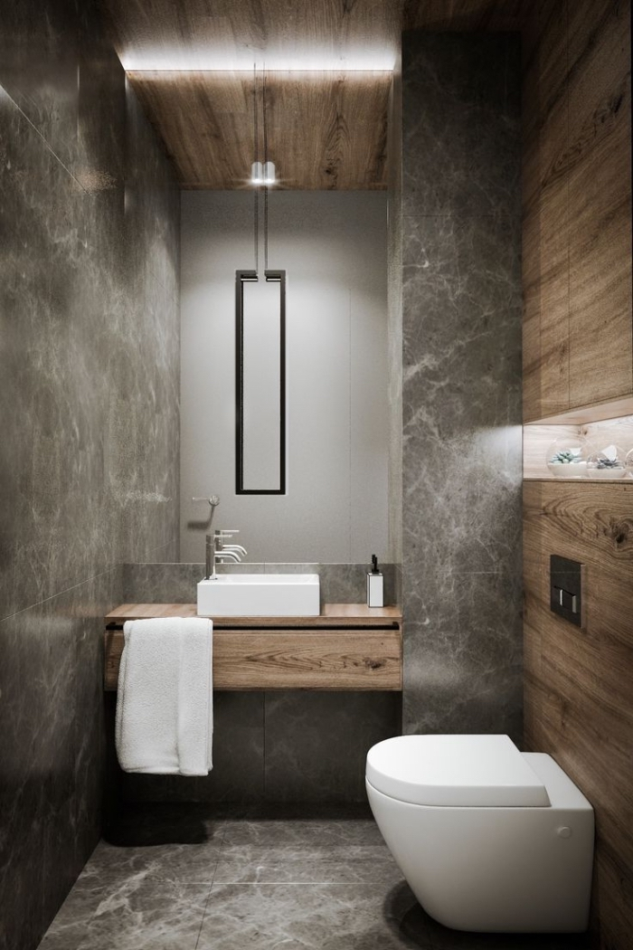 décoration toilette de style industriel avec revêtement mural effet bois et ciment, idée carrelage toilette effet marbre