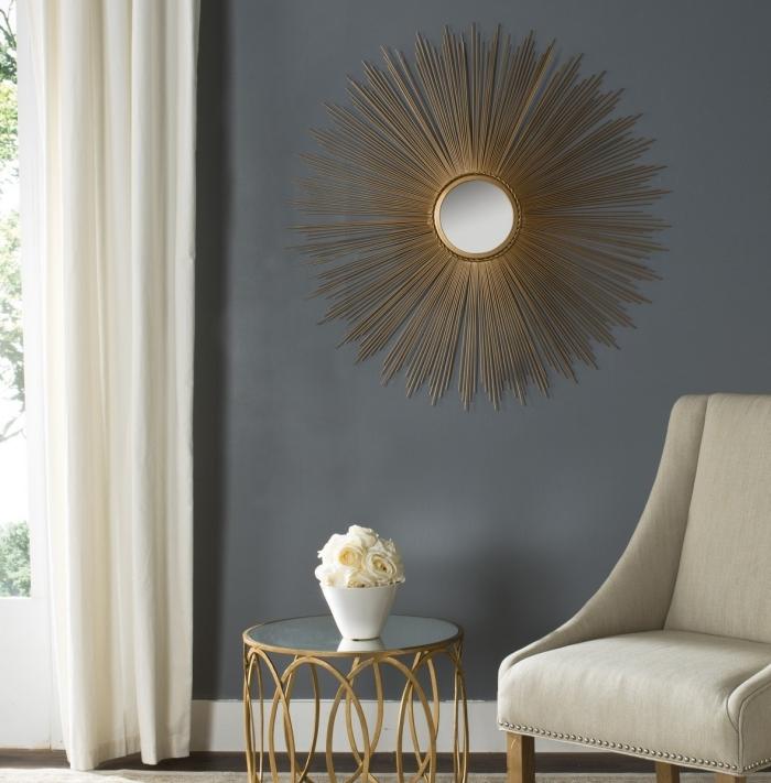 modèle de miroir decoratif à design soleil aux rayons dorés, idée peinture murale tendance 2019 nuances de gris