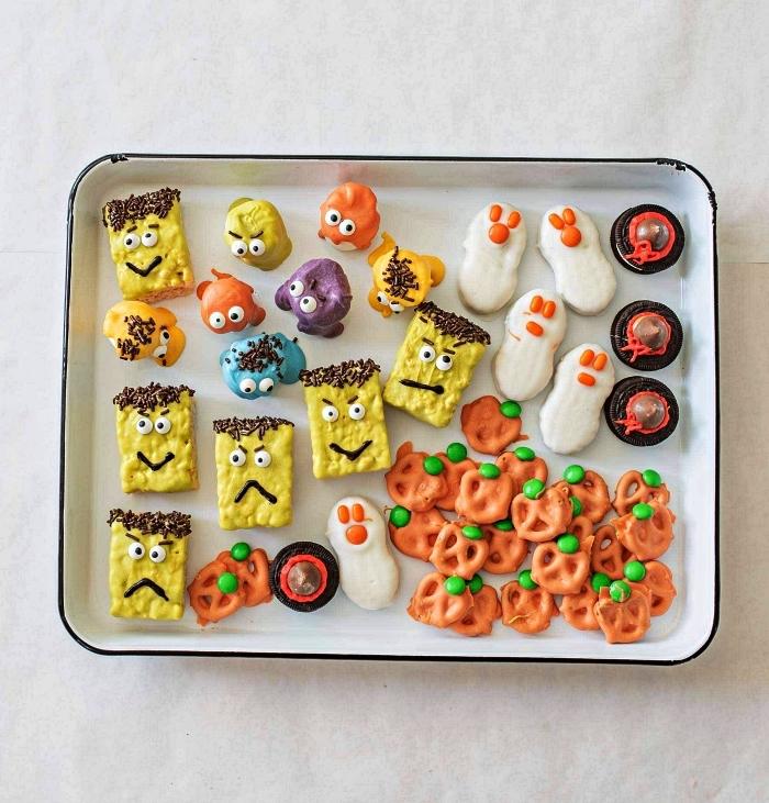 personnages d'halloween au riz soufflé pour l'apéritif halloween, barres de riz soufflé au glaçage coloré