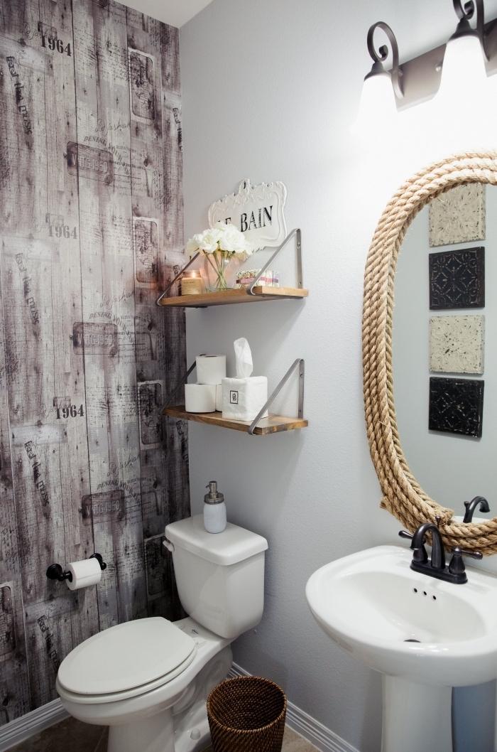 exemple comment refaire ses toilettes avec un papier peint à effet, modèle wc blanc avec accessoires en bois et corde
