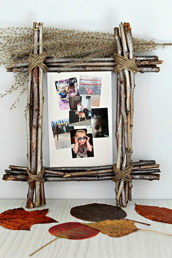 cadre photo nature fabriqué à partir des branches attachées ensemble avec de la corde de fil de chanvre