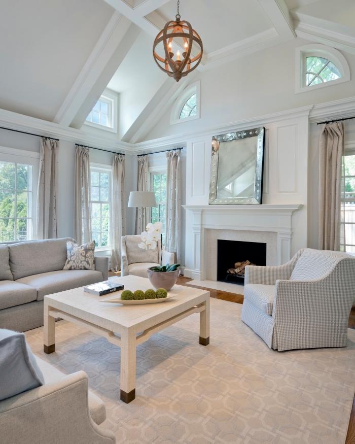 exemple de deco salon cosy aux murs neutres avec plafond originale à deux pentes et fenêtres, meubles salon en tissu