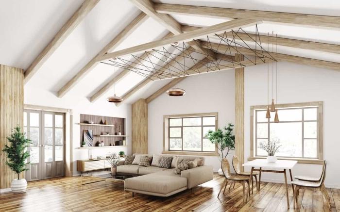 idée deco salon moderne en blanc et bois de style scandinave, aménagement espace ouvert à plafond à deux pentes