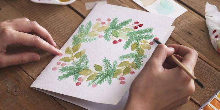 Couronne de Noël dessin sur carte de voeux, peinture aquarelle traineau pere noel dessin, idée dessin renne de noel
