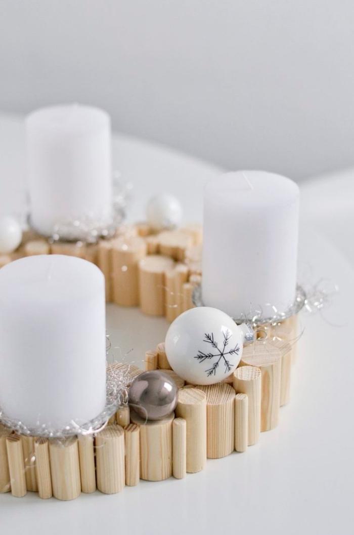 idée decoration de table de noel a faire soi meme, objet diy pour Noël en forme de couronne en bâtonnets de bois
