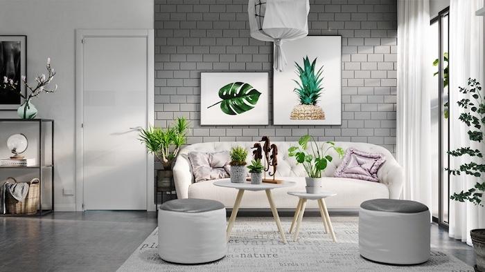 Gris accents dans une chambre couleur taupe clair, peinture bleu gris, nuance de gris et tableaux avec dessin de ananas et de feuille