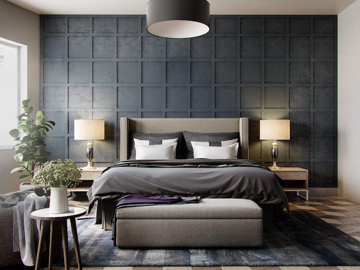 Gris sombre sur un des murs, lit confortable gris nuance, décoration chambre à coucher, peinture grise association