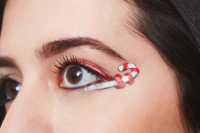 exemple comment faire un makeup noel facile sur les yeux avec eye-liner rouge et fards à paupières blancs en forme de dessin bonbon